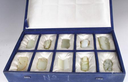 Ten Chinese celadon jade carvings of men, fruit, animal
