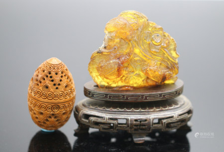 A Carved Amber Ornament And A Egg Shaped Incense Tube