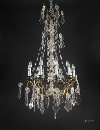 Paire de miroirs porte-lumière en bois doré à décor ajouré de feuillages et [...]