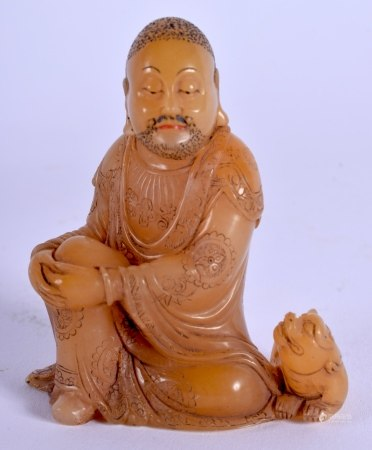 AN 18TH CENTURY SOAPSTONE FIGURE OF A LUOHAN Qianlong, modelled in draped robes resting both hands u