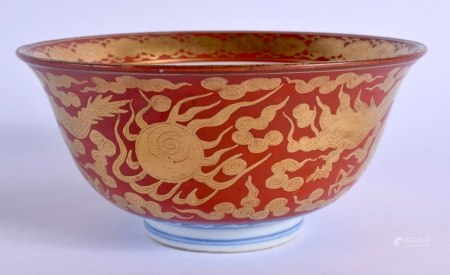 A 19TH CENTURY JAPANESE MEIJI PERIOD KUTANI PORCELAIN BOWL painted upon a coral ground with dragons.