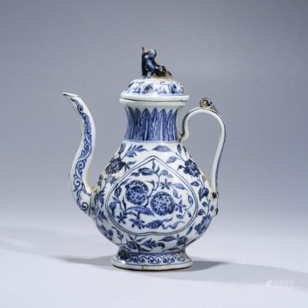 A  BLUE AND WHITE FLORAL PORCELAIN EWER