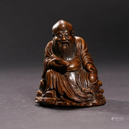 A CARVED BAMBOO 'OLD MAN' ORNAMENT