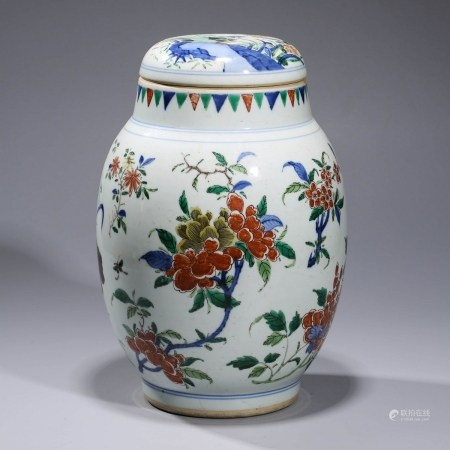 A  FAMILLE-VERTE 'FLOWER AND BUTTERFLY' PORCELAIN JAR AND COVER
