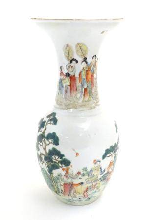 An Oriental baluster vase with an elongated neck and flared rim, the body decorated with figures and