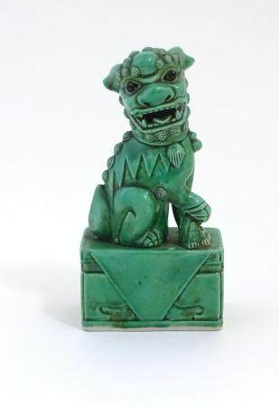 """A Chinese model of a seated dog of foo with a green glaze. Approx. 6 3/4"""" high Please Note - we do"""