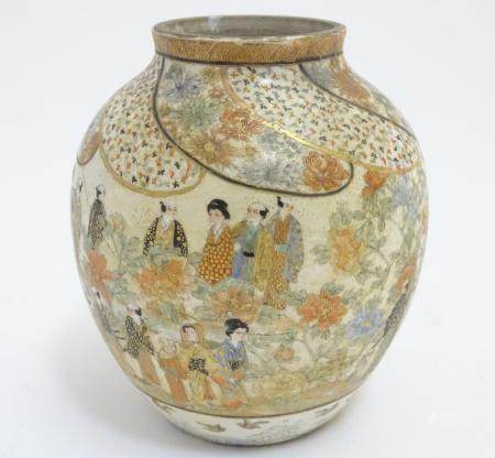 A Japanese Satsuma vase with hand painted decoration depicting figures, geisha girls etc. in a