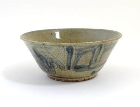 """A Chinese crackle glaze bowl with blue brushwork detail. Approx. 3 3/4"""" high x 8 3/4"""" diameter"""