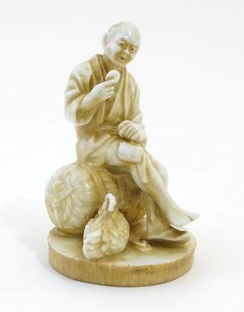 An Oriental figure modelled as a seated man holding an egg with a chicken by his feet. Impressed
