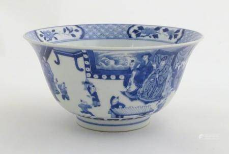 A Chinese blue and white footed bowl with a flared rim, decorated with a scene depicting the