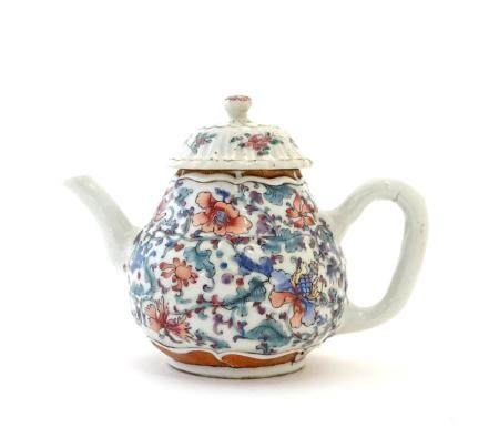 """A Chinese teapot with scrolling floral and foliate detail. Approx. 4 1/2"""" high Please Note - we do"""