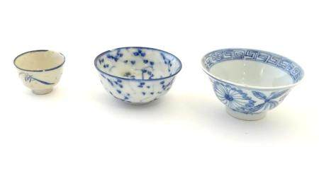 Three assorted Oriental blue and white wares to include saki cup, tea bowls etc. Character marks