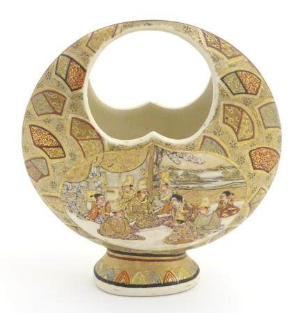 A Japanese satsuma moon basket vase with hand painted decoration depicting figures seated around