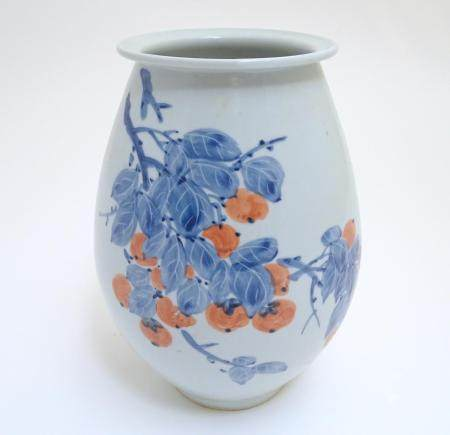 A Japanese vase of ovoid form with hand painted fruiting and foliate detail. Character marks to