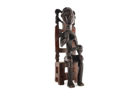 AN AFRICAN CARVED WOOD FIGURE