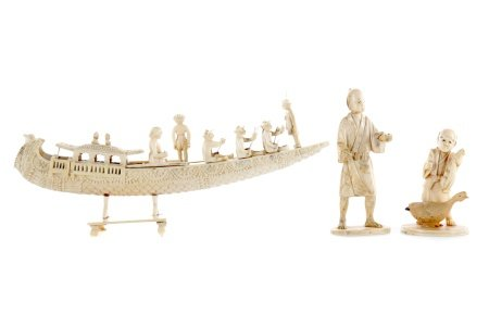 AN EARLY 20TH CENTURY INDIAN IVORY CARVING OF A BOAT AND TWO FIGURES