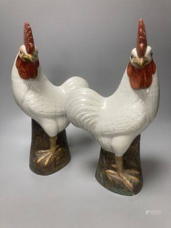A pair of Chinese porcelain models of cockerels, mid 20th century, 34.5cm high