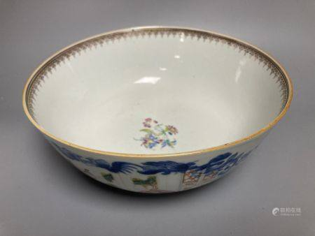 A Chinese famille rose punch bowl, Qianlong period, enamel painted in underglaze blue with famille