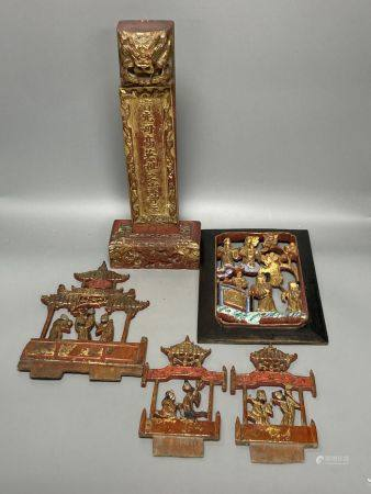 A group of Chinese lacquered wood carvings, tallest 40cm