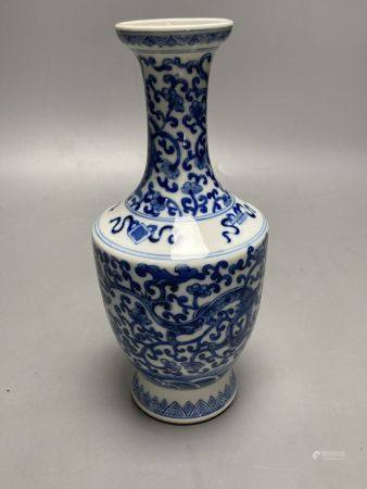 A Chinese blue and white dragon design vase, height 25cm