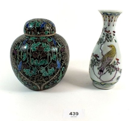 A Chinese porcelain vase with bird decoration, 17cm, together with a Chinese ginger jar