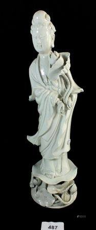 A Chinese blanc de chine figure of a woman, 35cm tall