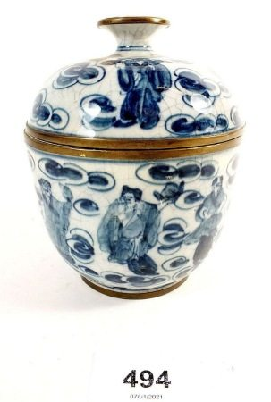 A Chinese Republic period blue and white jar with crackle glaze with brass metal banding.