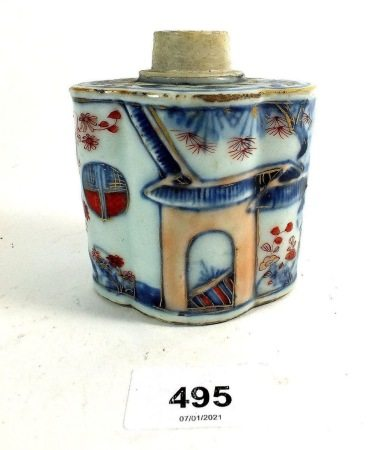 A Chinese tea caddy painted in underglaze blue and white with iron red garden scenes, 9cm, rim