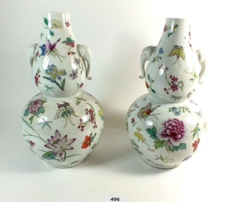 A pair of Chinese famille rose double gourd form vases painted flowers and butterflies, 30cm on