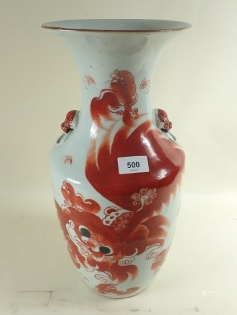 A large 19th century Chinese vase painted dragon with mask and ring handles to shoulders, 43cm tall