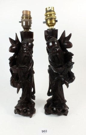 Two carved wood Chinese table lamps in the form of immortals, 30cm
