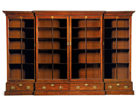 A GEORGE II MAHOGANY BREAKFRONT LIBRARY BOOKCASE  ATTRIBUTED TO WILLIAM HALLETT OR VILE AND COBB, CIRCA 1750