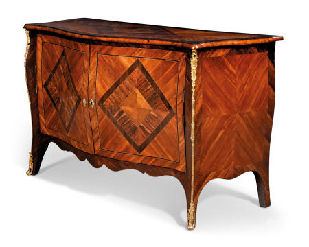A GEORGE III ORMOLU-MOUNTED ROSEWOOD, PLUM, WENGE, FUSTIC AND BOIS SATINE SERPENTINE COMMODE  ATTRIBUTED TO PIERRE LANGLOIS, CIRCA 1765