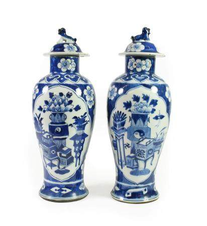 A Pair of Chinese Porcelain Baluster Vases and Covers, Qianlong reign mark but circa 1900, with