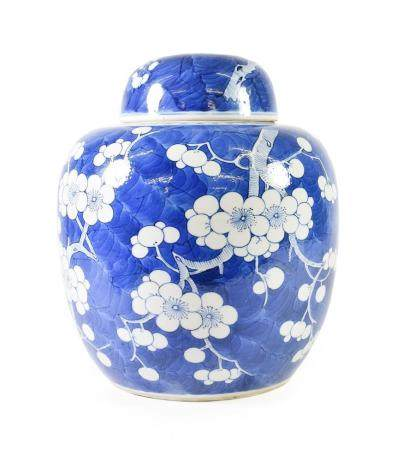 A Chinese Porcelain Jar and Cover, Kangxi reign mark but not of the period, of ovoid form, painted