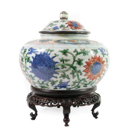 A Chinese Wucai Porcelain Jar and Matched Cover, in 17th century style, painted with bands of