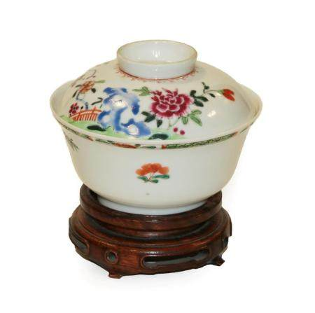 A Chinese Porcelain Rice Bowl and Cover, Qianlong, painted in famille rose enamels with foliage