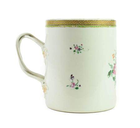 A Chinese Porcelain Mug, Qianlong, of cylindrical form with scroll handle, painted in famille rose