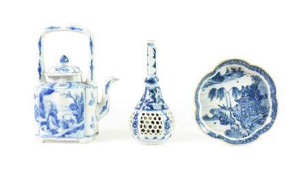 A Chinese Porcelain Wine Pot and Cover, Kangxi, of ogee rectangular form with overhead handle,