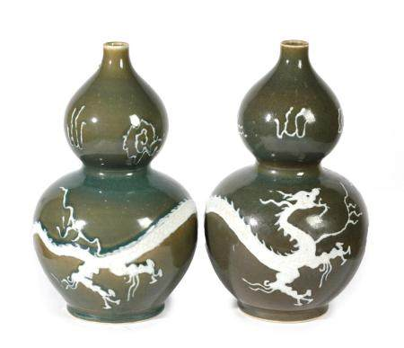 A Pair of Chinese Porcelain Double Gourd Vases, late Qing/Republic period, with carved white slip