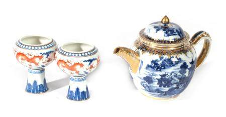 A Chinese Porcelain Teapot and Cover, Qianlong, of ovoid form, painted in underglaze blue with