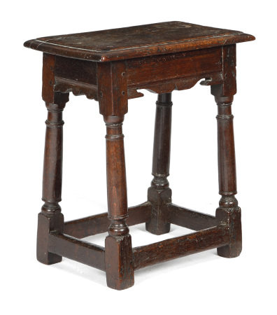 A CHARLES I OAK JOINT STOOL C.1630 the top with a moulded edge, above bi-cuspid shaped rails, on