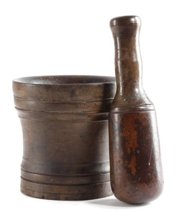 A TREEN WALNUT PESTLE AND MORTAR EARLY 18TH CENTURY both with remains of a painted finish, the