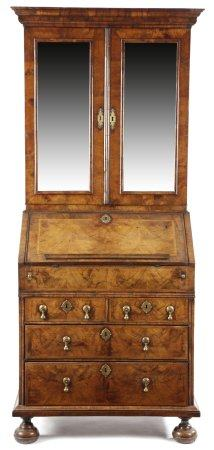 A GEORGE I WALNUT BUREAU BOOKCASE C.1715-20 with cross and feather banding, the moulded cornice