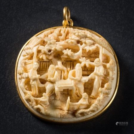 A late 19th Century Cantonese carved ivory low relief pendant: depicting figures in a woodland