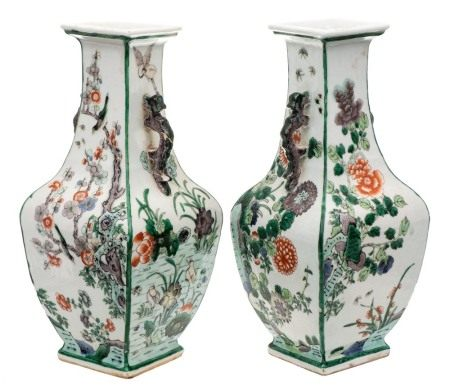 A pair of Chinese famille verte vases: of square baluster section with dragon handles,
