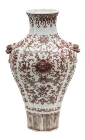 A Chinese underglaze copper-red decorated quadrilobed vase: with grotesque mask ring handles,