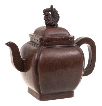 A Chinese Yixing stoneware teapot: of dark brown burnished finish and of canted square profile,