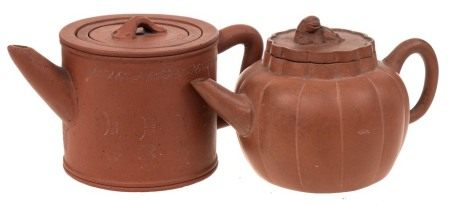 Two Chinese Yixing stoneware teapots: both of light brown hue,