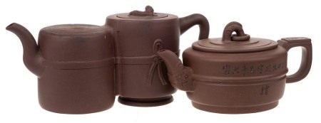 Two Chinese Yixing stoneware teapots: one of mid brown hue of squat and banded cylinder form with